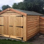 Finished Timber Garage With Log Store - The Wooden Workshop Oakford Devon
